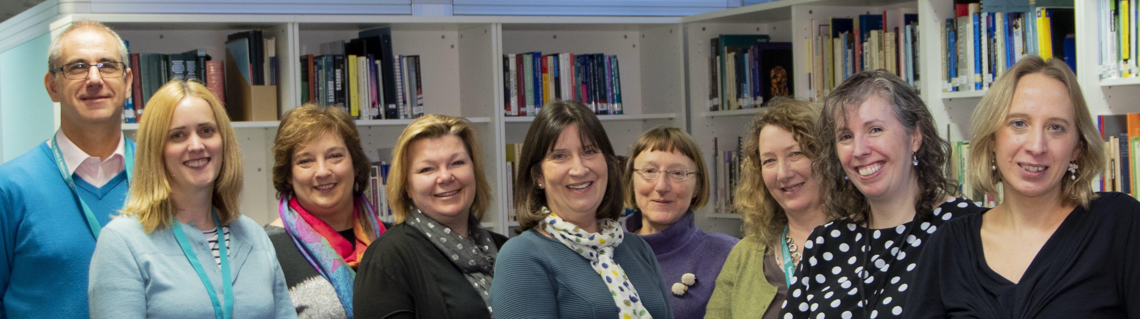 SHINE team in front of bookshelves
